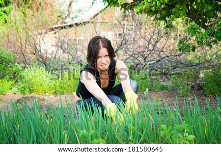 beautiful young  woman working in the garden
