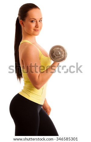 Beautiful young woman working out with dumbbells in fitness gym