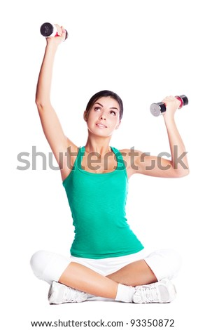 beautiful young  woman working out with dumbbells, isolated against white background - stock photo