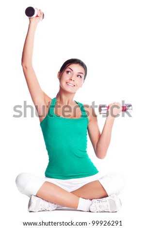beautiful young  woman working out with dumbbells, isolated against white background
