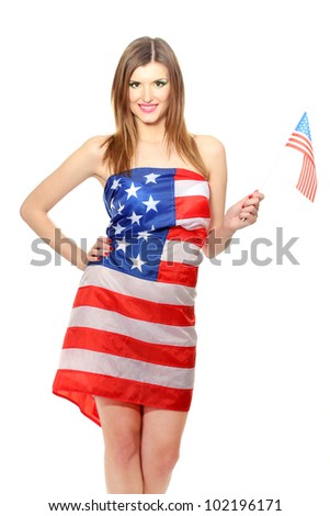 beautiful young woman wrapped in American flag isolated on white - stock photo