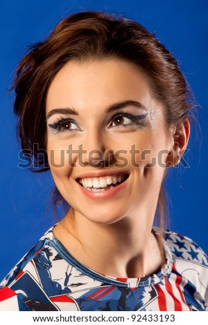 Beautiful young woman wrapped. On blue background - stock photo