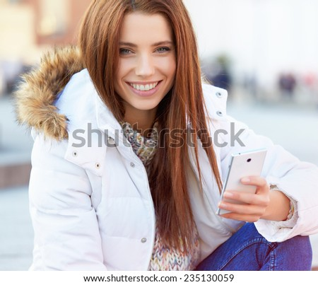 beautiful young woman writing a message  - stock photo