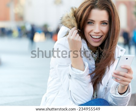 beautiful young woman writing a message. Smiling Girl.  - stock photo
