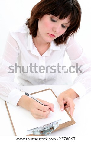 Beautiful young woman writing with pen on clipboard.