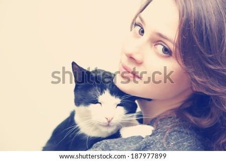 beautiful young woman 20 years  with monochrome black and white cat, with instagram effect - stock photo