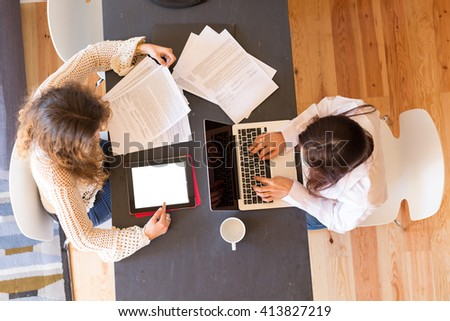 Beautiful young women at home studying for the final exams