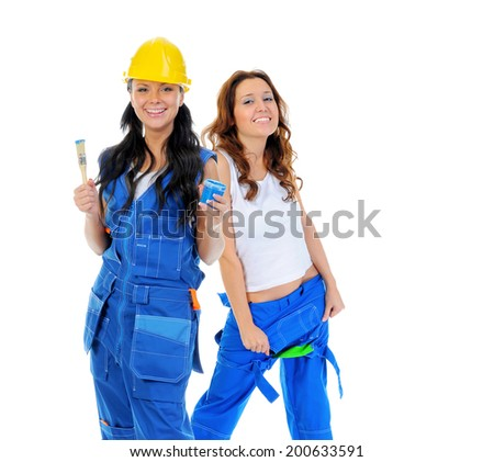 Beautiful young women doing repairs isolated on white background - stock photo