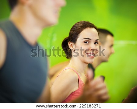 Beautiful young women exercising in a fitness center - stock photo