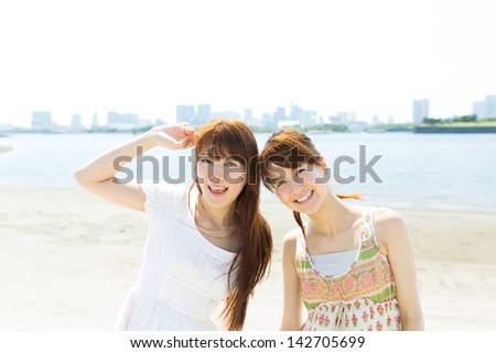 Beautiful young women on beach summer holiday