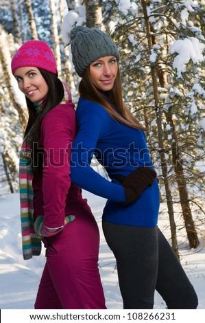 Beautiful young women outdoor in winter - stock photo