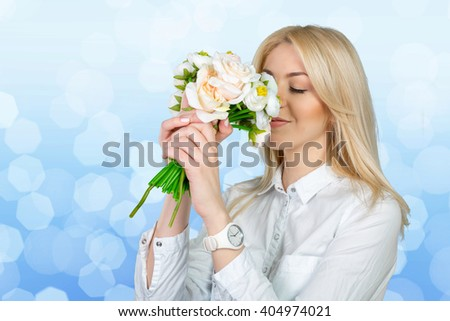 Beautiful young women with flowers - stock photo