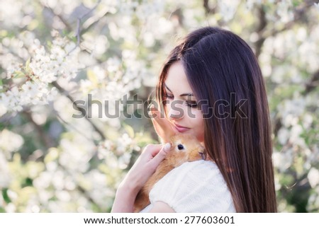 beautiful young women with rabbit - stock photo