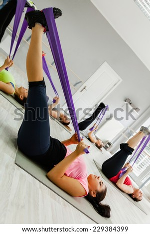 Beautiful Young Women Workout At Fitness Center With Gym Tensile