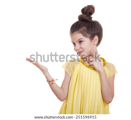 Beautiful youth little girl presenting copy space, studio on white background  - stock photo