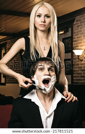 beautiful youth woman  with blindfold,  get shave guy  hazardous razor - stock photo
