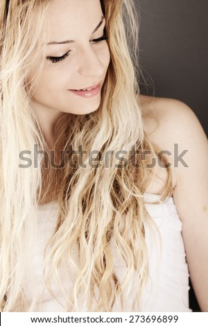 Beautiful zoung woman with messy hair - stock photo