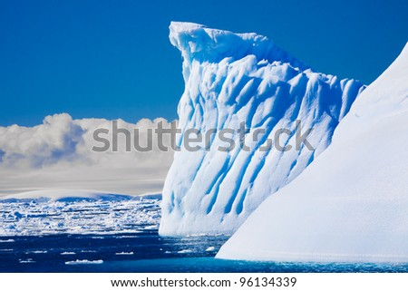 Beautifull big antarctic iceberg in the snow