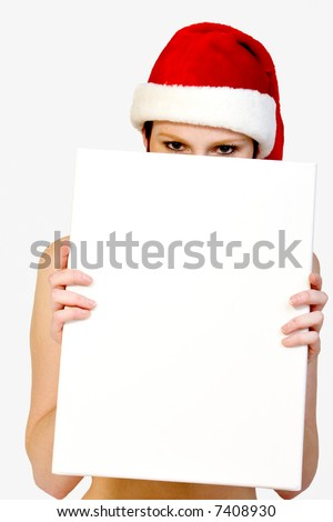 Beautifull girl in christmas bikini and with christmas hat is hlding up a white sign for copy space. With background clipping path for your convenience