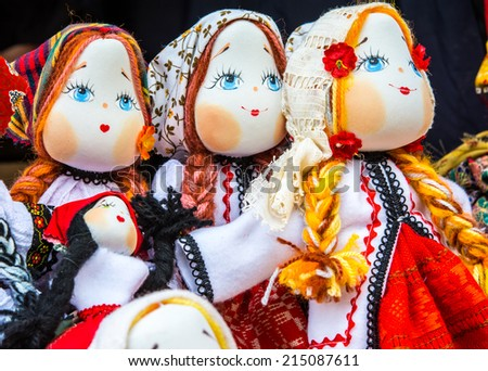 Beautifull girl toy: romanian handmade dolls in tradiditional costume - stock photo