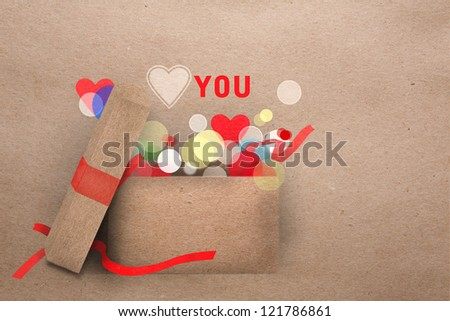 Beautifull natural paper applique Valentine greeting card with an open gift box emitting round part lights and the message Love you with a symbolic heart and copyspace - stock photo