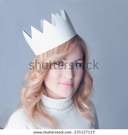 Beautifull woman in a paper crown. Queen. New Year celebration. Blond woman - stock photo