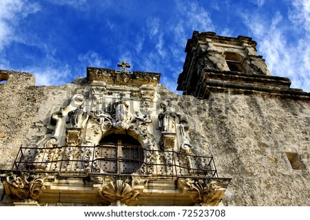 Beautifully carved front tower and balcony with statuary at the historic Mission San Jose, an eighteenth century Spanish Mission near San Antonio, Texas. - stock photo