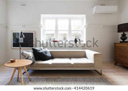 Beautifully Danish styled interior living room of sofa and coffee table in a renovated apartment - stock photo