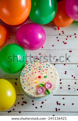 Beautifully decorated birthday cake with lighted candles - stock photo