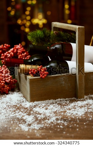 Beautifully decorated box with bottles of wine on unfocused background - stock photo