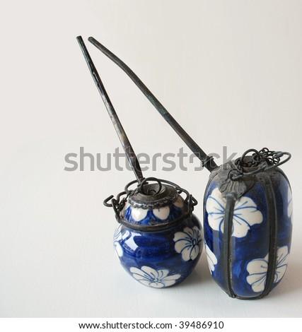 Beautifully decorated Cambodian Opium pots - stock photo