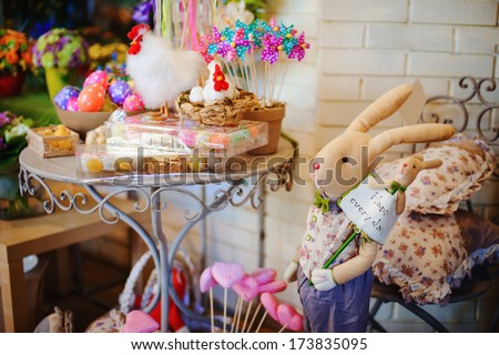 beautifully decorated Easter holiday table with hens and eggs - stock photo
