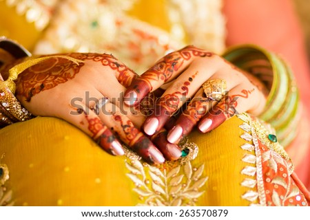 beautifully decorated Indian bride hands, Soft Focus. - stock photo