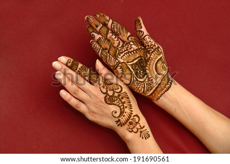 beautifully decorated indian hands with mehandi typically done for weddings - stock photo