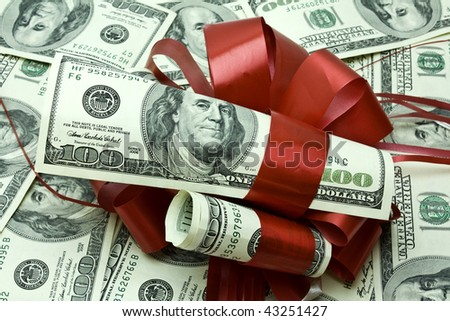 beautifully decorated money by a large plan - stock photo