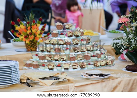Beautifully decorated party setting with gourmet desserts - stock photo