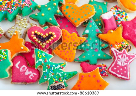 Beautifully decorated pile of cookies on the white plate.
