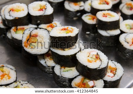 Beautifully decorated sushi on a plate. Sushi is the traditional Asian food. Roll of sushi prepared from raw fish and a special rice. Diet healthy food. - stock photo