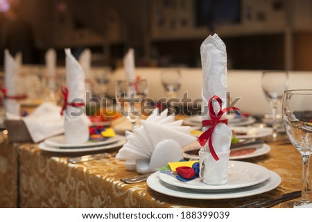 beautifully decorated table in the restaurant for a wedding - stock photo