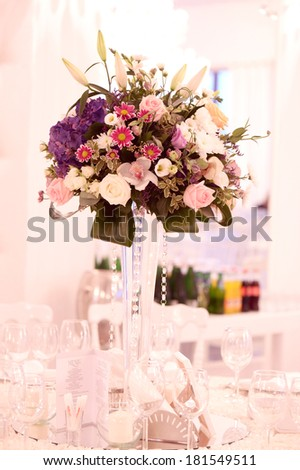 Beautifully decorated wedding table with flowers - stock photo