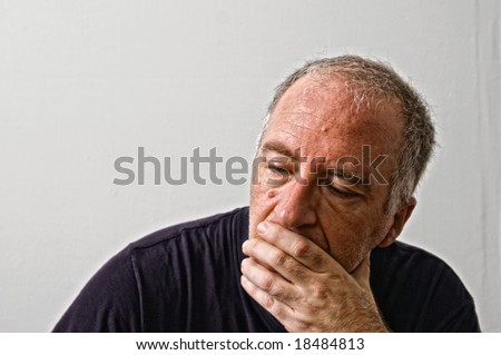beautifully detailed real portrait of concerned looking adult white man looking like he is planning something - stock photo