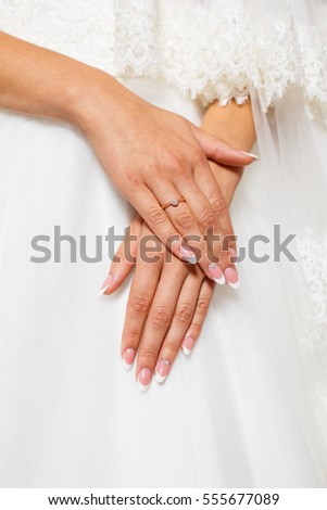 Beautifully folded hands bride with a wedding ring