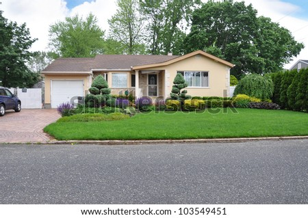 Beautifully Landscaped Suburban one story Home in Residential Neighborhood - stock photo