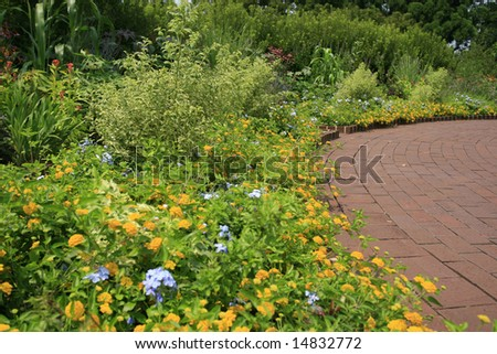 Beautifully landscaped summer garden - stock photo