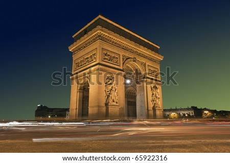 Beautifully lit Arc de Triomphe at sunset, Paris France - stock photo