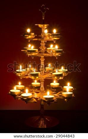 "Beautifully Lit Lamp with the Hindu Sacred Symbol ""Om"" - stock photo"