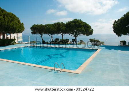 Beautifully located swimming pool with ocean views - stock photo