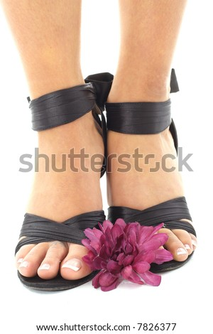 beautifully manicured feet with flowers - stock photo