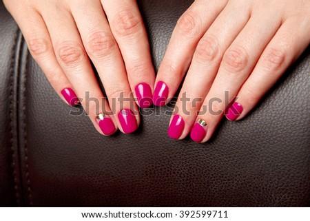 Beautifully Manicured Fingernails With Fuchsia Nail Polish On A Black Skin Background