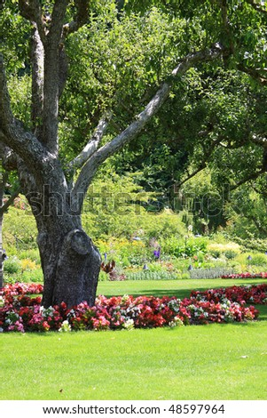 Beautifully manicured park garden, also available in horizontal. - stock photo